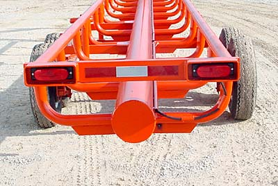 "Orange Ox - Orange Ox Self Un-loading Hay Trailers - The tail lights are protected by heavy box tubing and the wiring is protected by schedule 40 pipe. This picture also shows the one piece els (no welds to break), reinforced by ¼"" x 2"" flat steel."