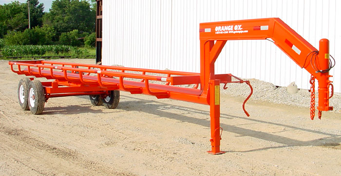 Orange Ox - Orange Ox Self Un-loading Hay Trailers - Ready to save you time and money. Call today for the best trailer at the best price!