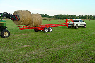 Orange Ox - Orange Ox Self Un-loading Hay Trailers - Loading